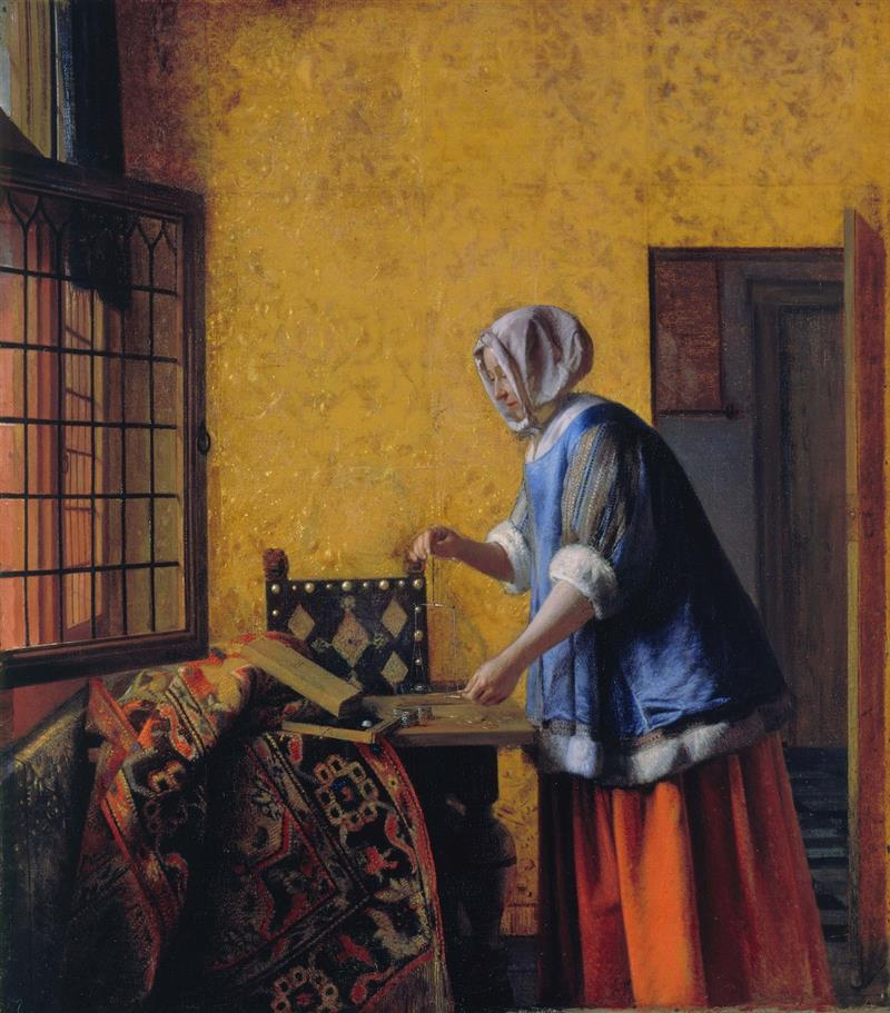 Woman weighing gold coin