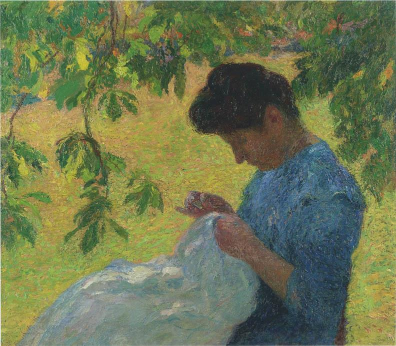 Young woman sewing in garden